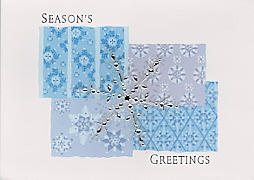 foil snowflake on patterned background